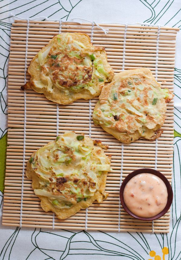 "<strong>Get the <a href=""http://fiveandspice.com/2011/06/30/okonomiyaki-with-garlic-scapes/"" target=""_blank"">Okonomiyaki With"