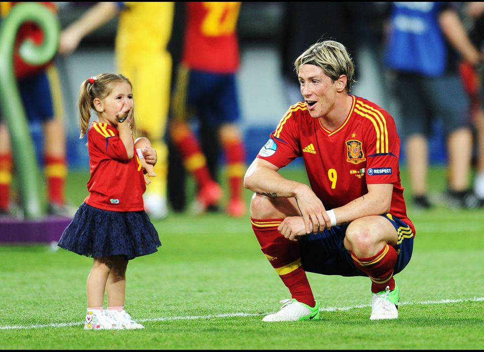 Fernando Torres of Spain speaks with his daughter Nora Torres after the UEFA EURO 2012 final match between Spain and Italy at