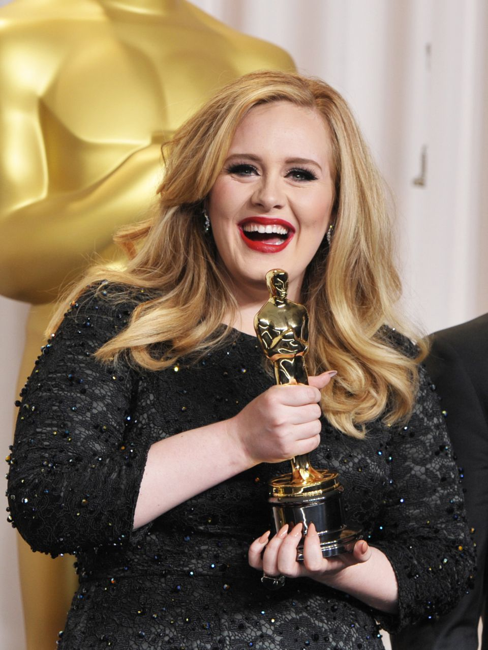"Adele poses with her award for best original song for ""Skyfall"" during the Oscars at the Dolby Theatre, L.A., on Feb. 24, 201"