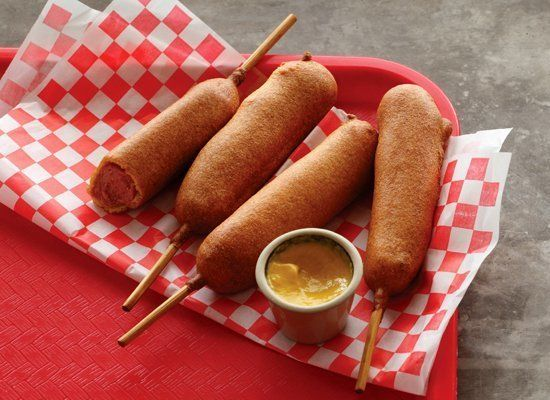 """<strong>Get the <a href=""""http://www.huffingtonpost.com/2011/10/27/corn-dogs_n_1061348.html"""" target=""""_hplink"""">Corn Dogs recipe"""