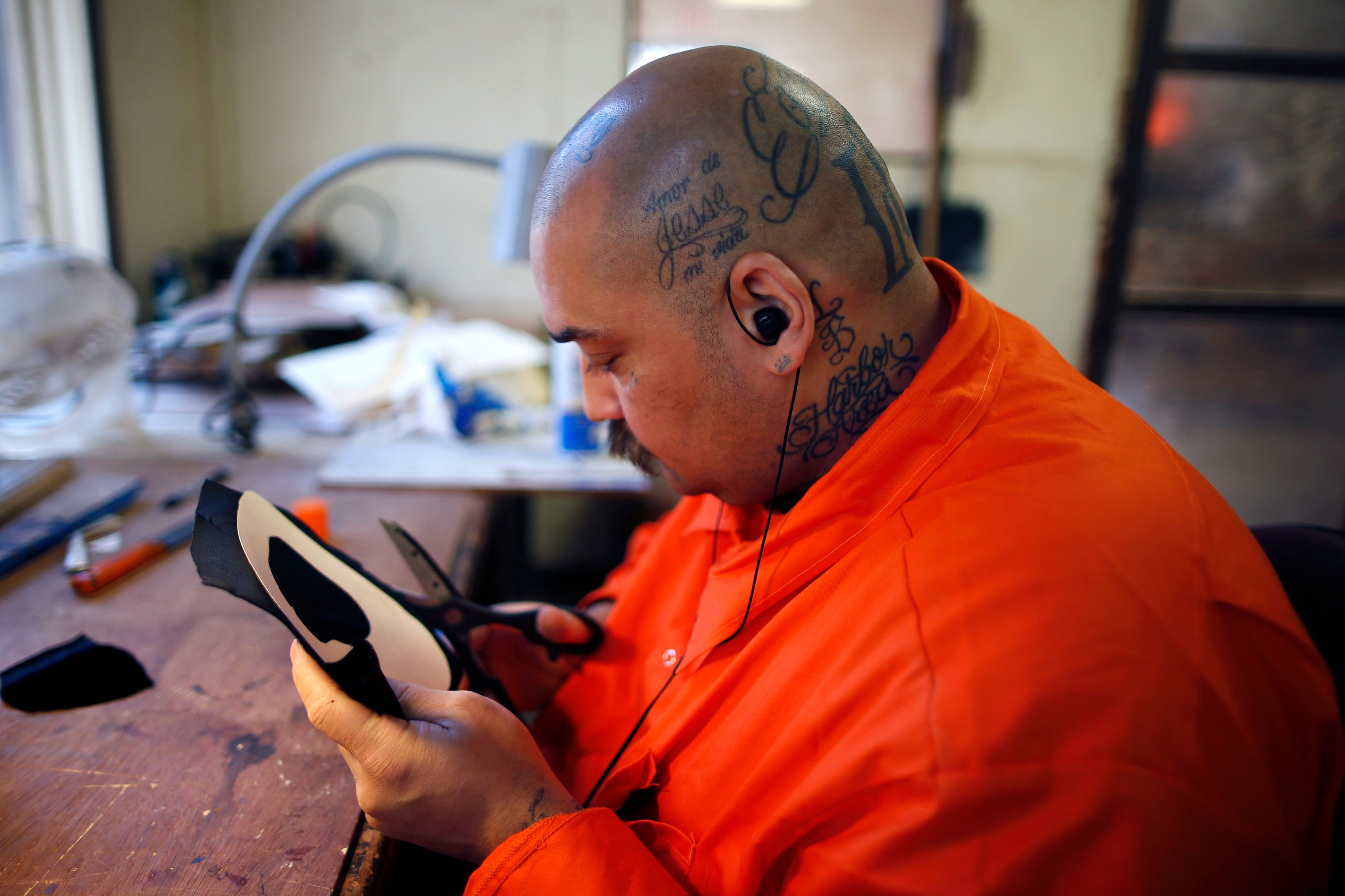 A prison inmate cuts out a heart to line a wooden jewelry box he made at Oak Glen Conservation Fire Camp #35 in Yucaipa, California November 6, 2014. Thousands of convicted felons form the backbone of California's wildfire protection force under a unique and little-known prison labor program. But California may soon find it harder to recruit new inmate firefighters after a ballot measure was passed last month to ease prison crowding by reducing felony sentences to misdemeanor jail terms for most non-violent, low-level offenses, including many drug crimes. That measure will likely diminish the very segment of the inmate population that the California Department of Forestry and Fire Protection, or Cal Fire, draws upon to fill its wildland firefighting crews. Picture taken November 6. To match Feature USA-FIREFIGHTERS/CALIFORNIA      REUTERS/Lucy Nicholson   (UNITED STATES - Tags: CRIME LAW SOCIETY)