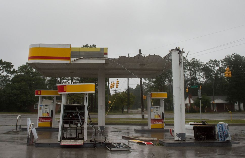 The roof of a gas station is destroyed from strong winds as Hurricane Florence passes over in Wilmington, North Carolina on F