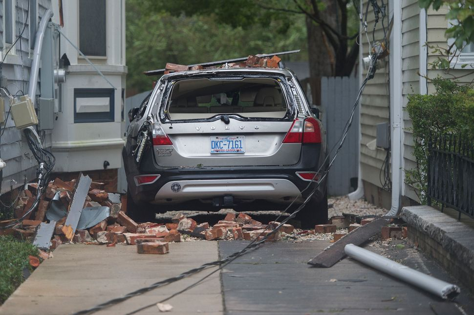 A car is destroyed from falling bricks as Hurricane Florence passes over Wilmington, North Carolina on Friday.
