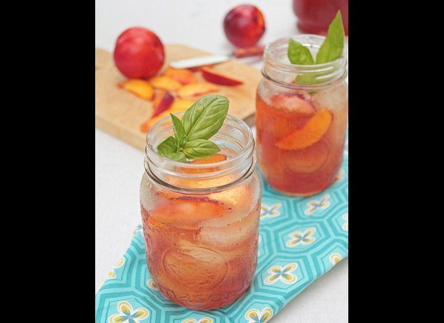 "<strong>Get the <a href=""http://whatsheshaving.com/2011/08/07/nectarine-basil-iced-tea/"" target=""_hplink"">Nectarine Basil Ice"