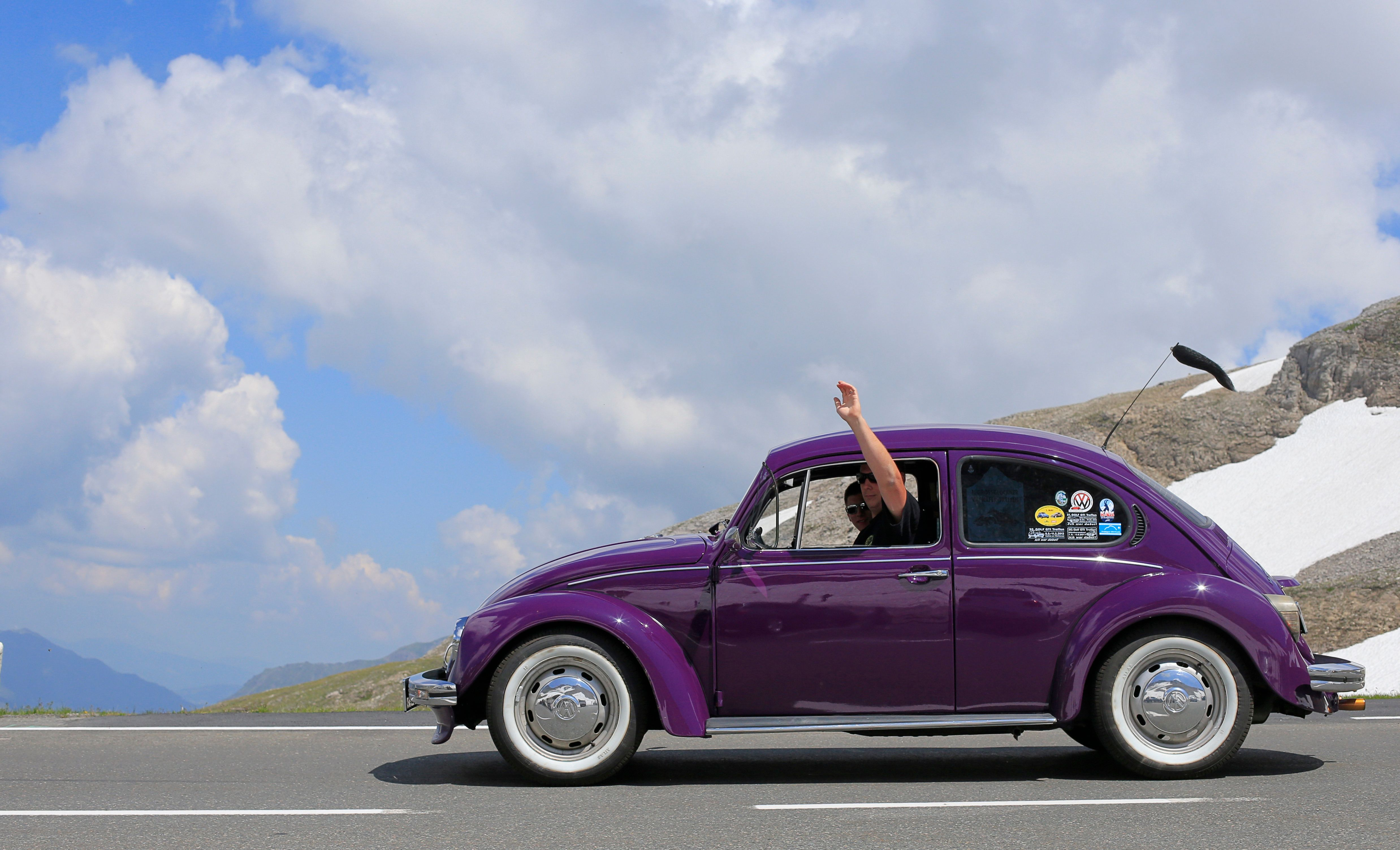 Historic car enthusiasts drive a vintage Volkswagen Beetle during a classic car excursion on the Grossglockner high alpine road (Grossglockner-Hochalpenstrasse), at the Hochtor pass in the mountains of the Hohe Tauern, near Zell am See, on July 21, 2013. The famous 48-kilometer long Austrian road is among the most renowned alpine roads with spectacular scenic views. AFP PHOTO / ALEXANDER KLEIN        (Photo credit should read ALEXANDER KLEIN/AFP/Getty Images)