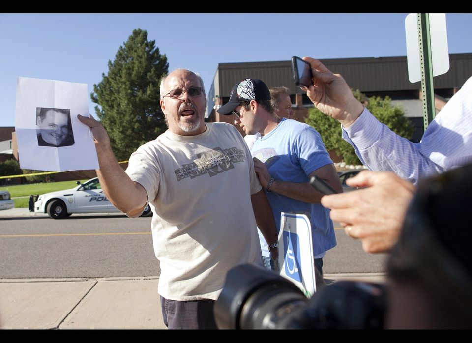 Tom Sullivan , holds a photograph of his son, Alex Sullivan, as he pleads with the media to help him find his son, outside Ga