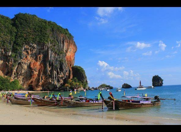 Near the holiday center of Krabi, the stunning Phra Nang beach is presided over by the massive limestone karst that stands in
