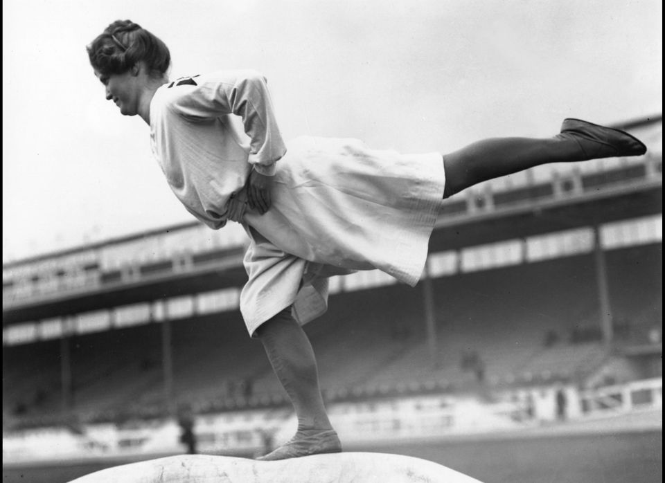 Before there were leotards, competitors wore something akin to a dress.   (Photo credit: Hulton Archive)