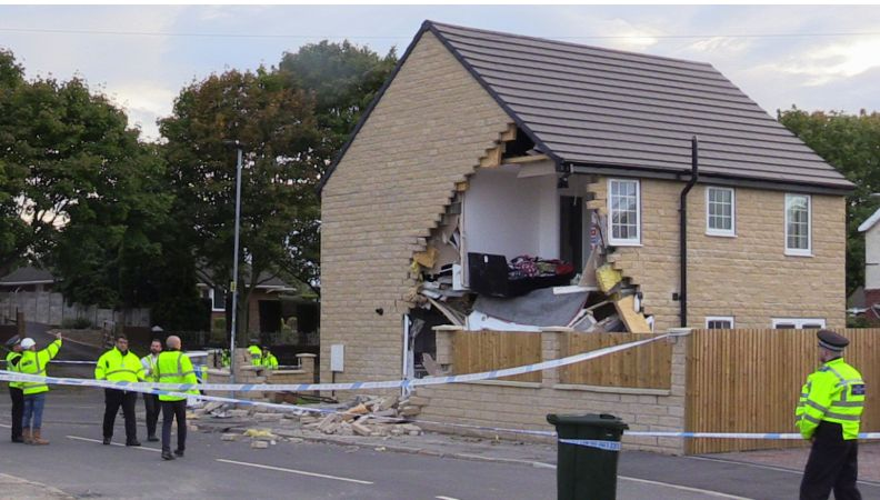 Pedestrian Killed After Lorry Crashes Into The Side Of A House In