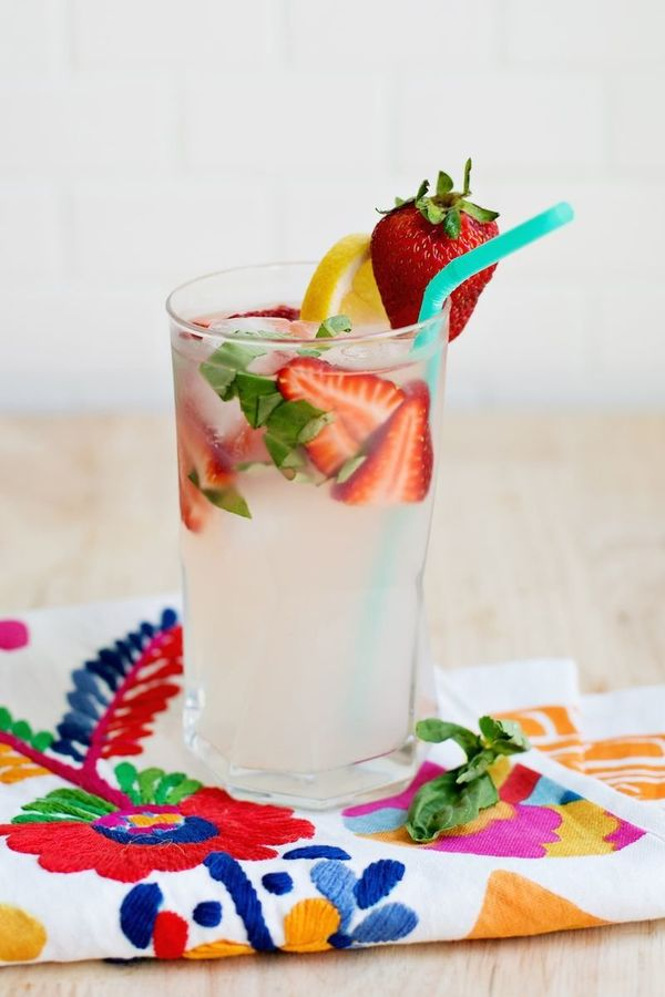 "<strong>Get the <a href=""http://www.abeautifulmess.com/2014/08/strawberry-basil-lemonade-cocktail-.html"" target=""_blank"">Stra"