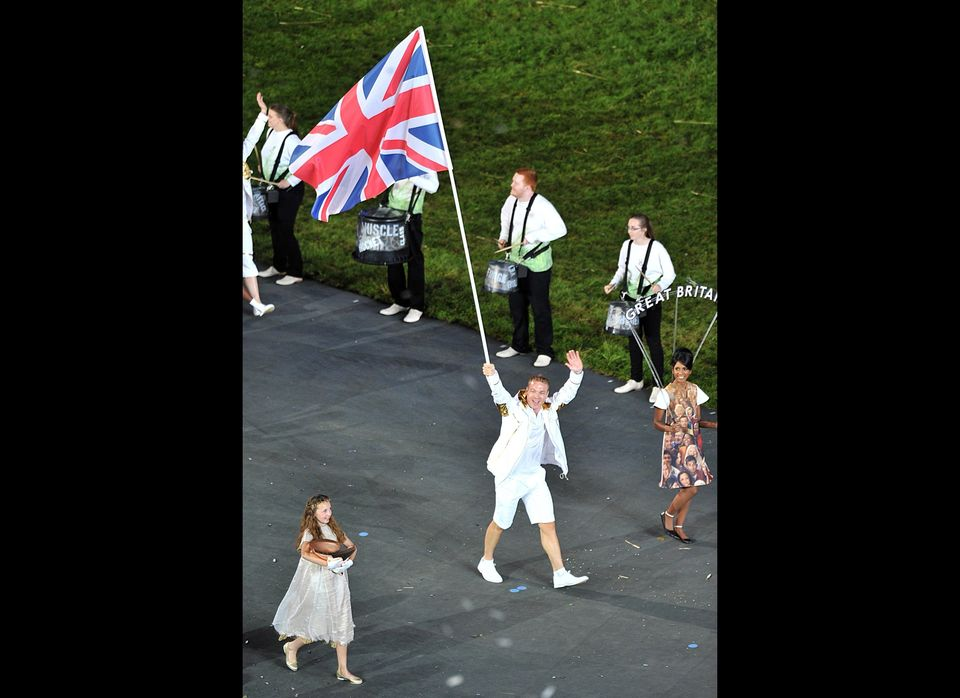 Team GB, led by flagbearer Sir Chris Hoy, enter the stadium during the London Olympic Games 2012 Opening Ceremony at the Olym