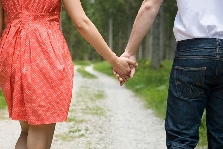 Young couple holding hands - IS360-010