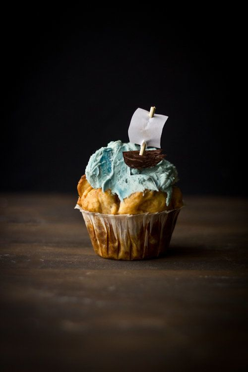 """<strong>Get the <a href=""""http://adventurescooking.blogspot.com/2012/02/buttered-rum-cupcakes-and-pirate.html"""" target=""""_hplink"""