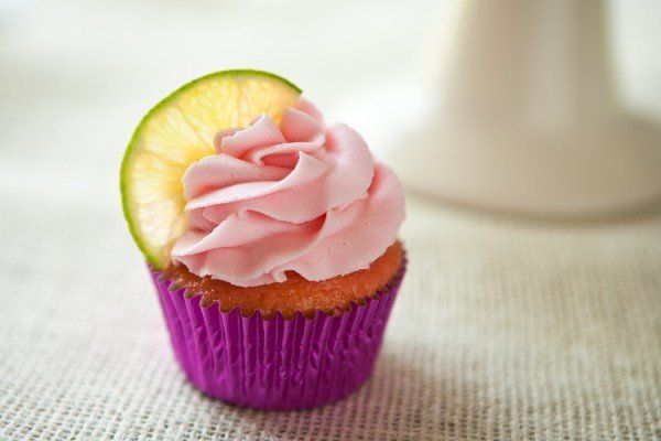 """<strong>Get the <a href=""""http://eclecticrecipes.com/strawberry-margarita-cupcakes"""" target=""""_blank"""">Strawberry Margarita Cupca"""