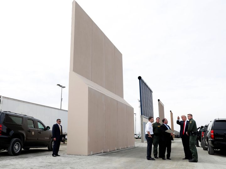 President Donald Trump inspects U.S.-Mexico border wall prototypes in San Diego on March 13. He promised hundreds of times th
