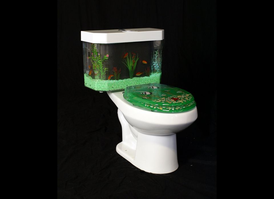 Talk about bringing a natural element into your bathroom: the top of this toilet actually functions as a working fish tank! I