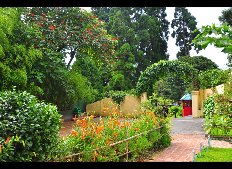 Part of the hilltop gardens at The Windamere, maintained as they were in 1939. Security is stationed in the little red guard