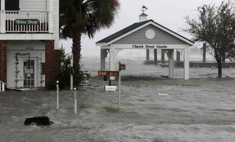 High winds and water surround buildings as Hurricane Florence hits Front Street in downtown Swansboro, North Carolina on Frid