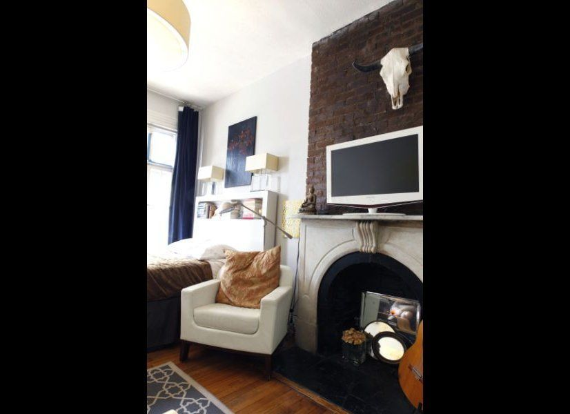 The front room was originally used as the parlor before the brownstone was divided into apartments.