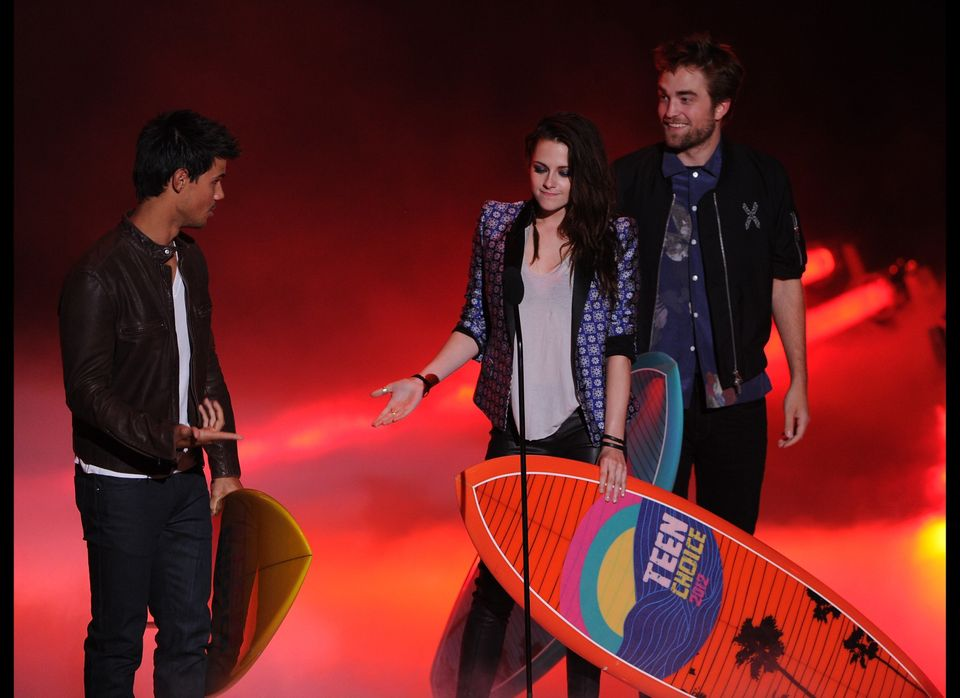 Actors Taylor Lautner, Kristen Stewart, and Robert Pattinson accept the Ultimate Choice award onstage during the 2012 Teen Ch