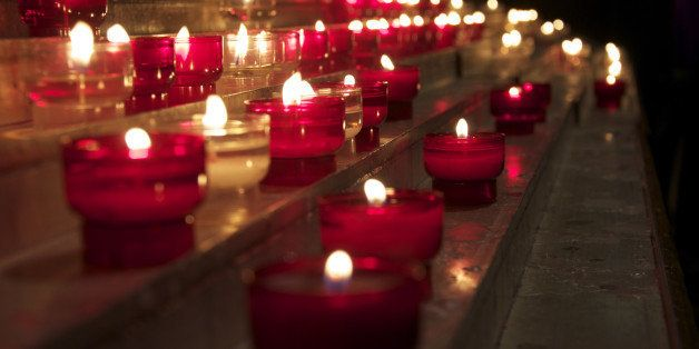 candles flicker in a church in...