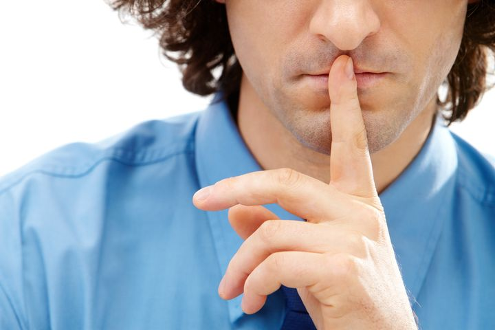 Image of gesture: male finger over lips