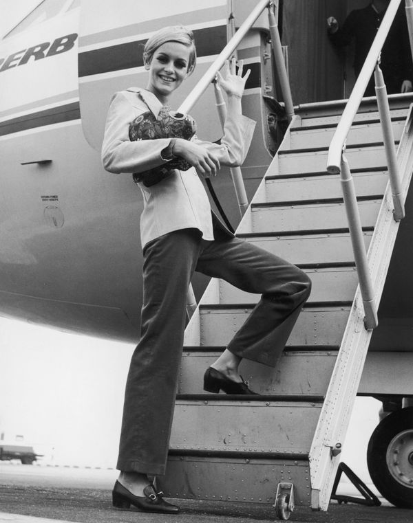 Twiggy boards an aircraft at London's Heathrow Airport, bound for Tunisia on an export drive for Berkertex.
