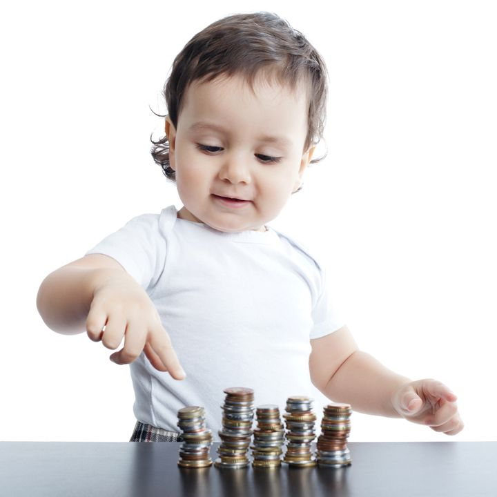 little boy plays with coins