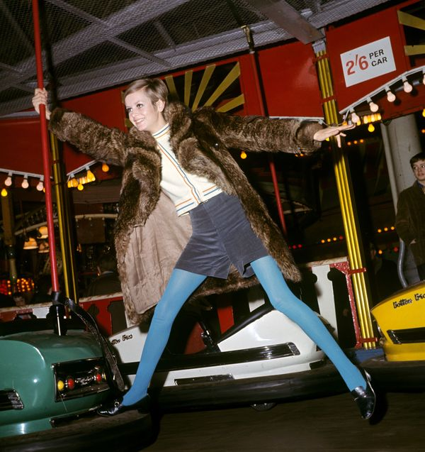 Twiggy poses with bumper cars at the Bertram Mills Circus.