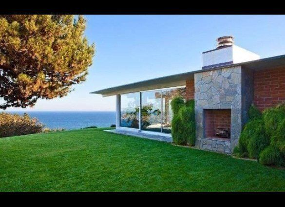 The 4 bed, 4 bath, 4,088 square foot home on the Encinal Bluffs faces Point Mugu State Park on one side and the Pacific Ocean