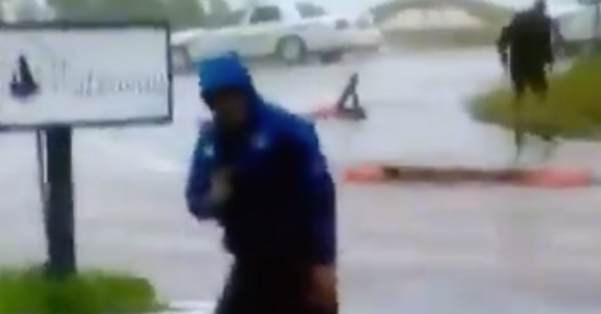 Weatherman In Wilmington Braces For Hurricane While 2 Guys Walk By As If Nothing's Wrong