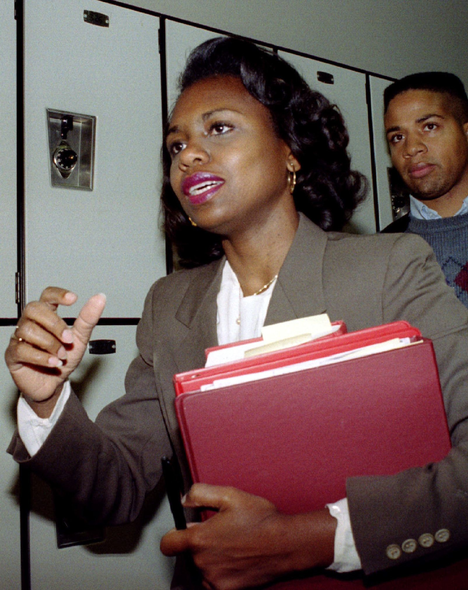 FILE PHOTO OCT 91 - Anita Hill is shown while going to a law school class at the same time of the Thomas confirmation hearings in 1991. Oklahoma University law school Dean C. Peter Goplerud said March 16 that Hill would resign her teaching post efective at the end of the school year. Hill was at the center of the Clarence Thomas Supreme Court nomination hearing after she accused Thomas of sexually harassing her in the 1980's