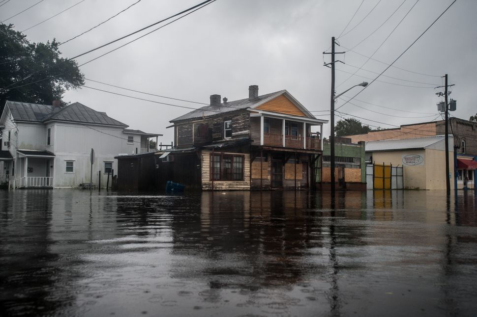 Flooding began in downtown Washington, North Carolina, on Thursday night as Hurricane Florence made landfall, and continued e