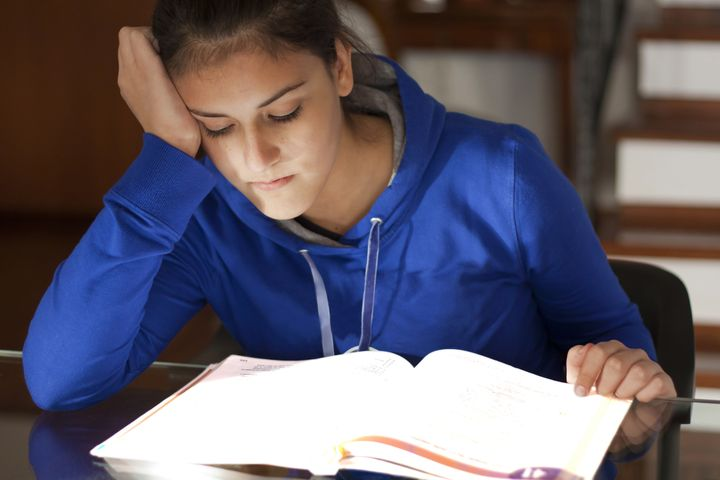 tired  listless girl studying a ...