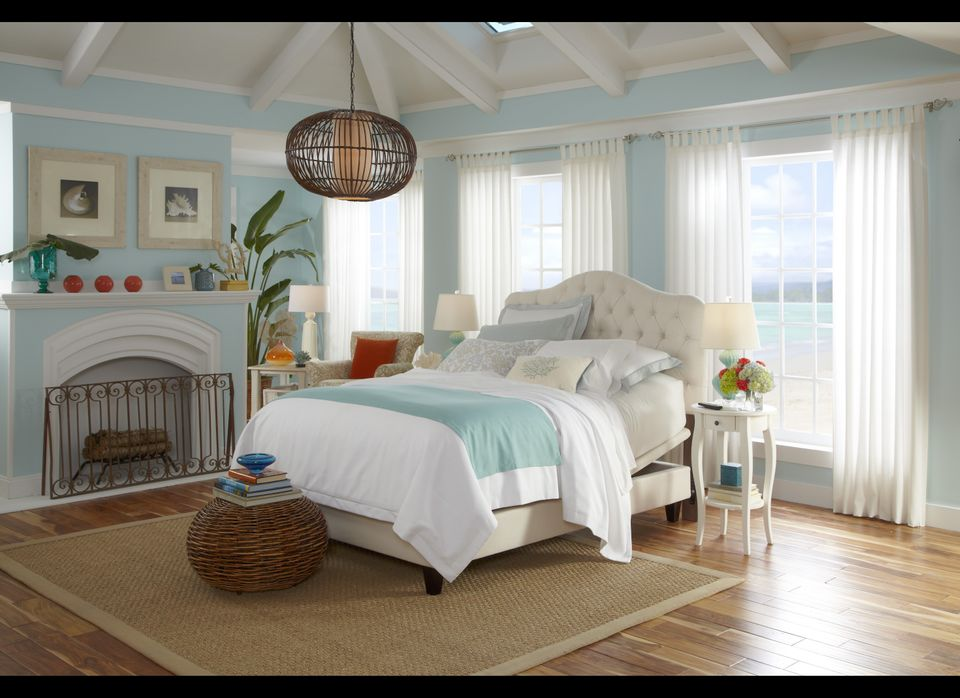 This room is serene and relaxing with its cool, blue walls and bed accents.