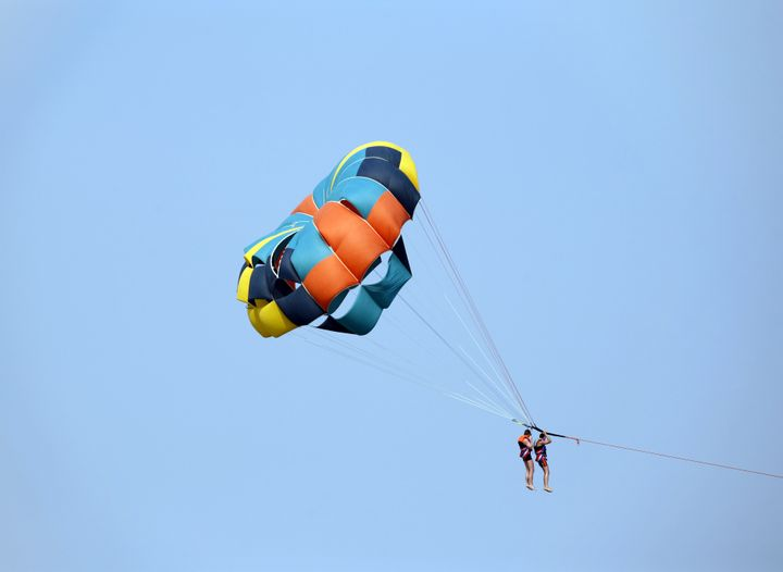 photo of a parachute with two...