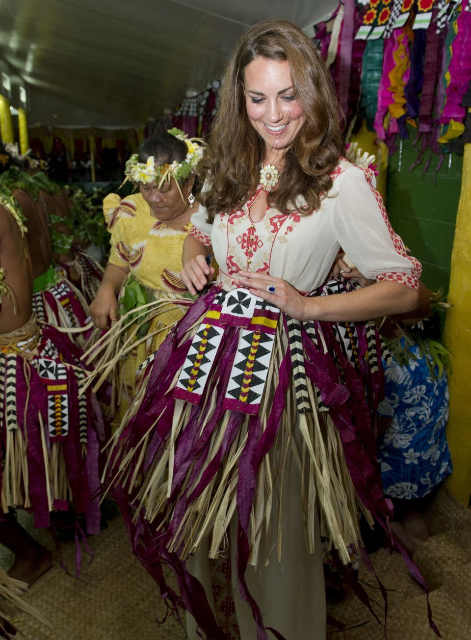 The Duchess of Cambridge gets into costume with locals at Vaiaku Falekaupule during a visit to Tuvalu, Solomon Islands, durin