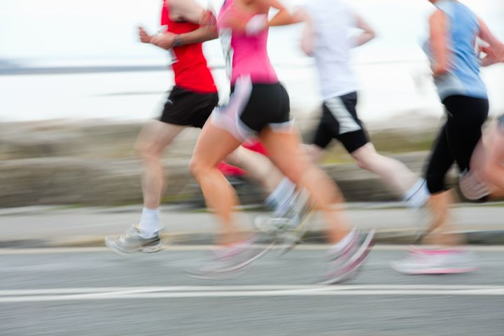 group of runners compete in the ...