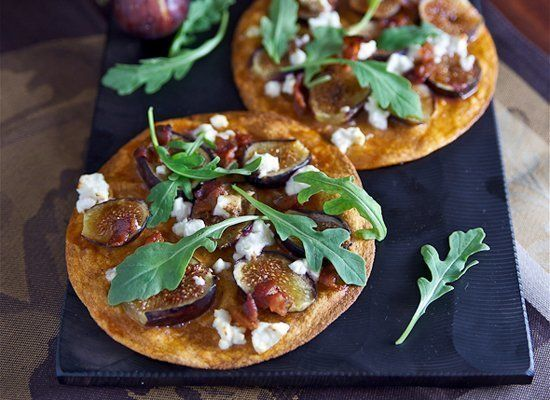 """<strong>Get the <a href=""""http://lemonsandanchovies.com/2012/09/tortilla-pizza-with-figs-feta-bacon-and-arugula/"""" target=""""_hpl"""