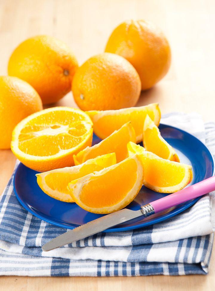 Sliced Fresh Juicy Navel Oranges on Plate