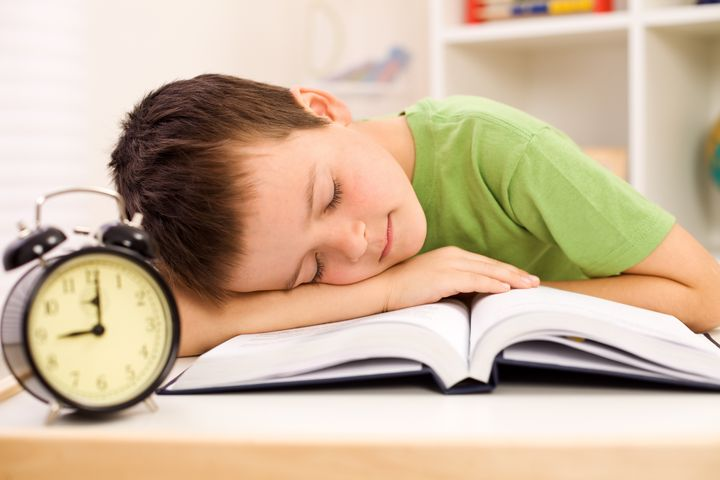 boy fallen asleep on his book...