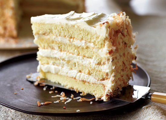 This impressive cake features four layers of rum-brushed yellow cake filled and frosted with a coconut-scented meringue-butte