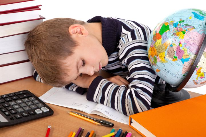 tired schoolboy isolated on a...