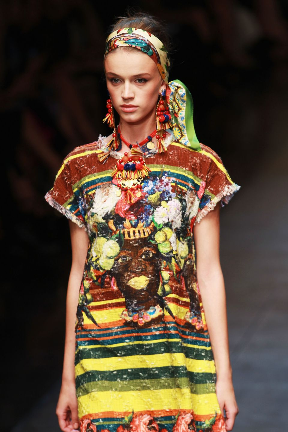MILAN, ITALY - SEPTEMBER 23:  A model walks the runway at the Dolce & Gabbana Spring/Summer 2013 fashion show as part of Mila