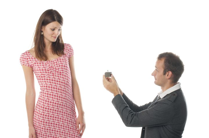 Proposal scene with sad woman and man.