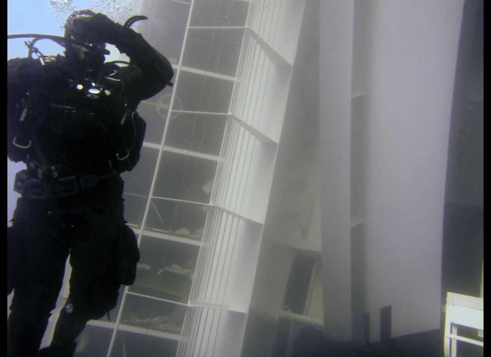 In this underwater photo taken on Jan. 13 and released by the Italian Coast Guard Monday, Jan. 16, 2012 a scuba diver swims n