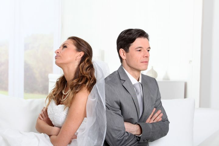 Bride and groom being mad at each other