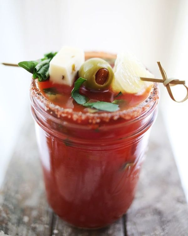 """<strong>Get the <a href=""""http://www.abeautifulmess.com/2013/06/basil-bloody-mary.html"""" target=""""_blank"""">Basil Bloody Mary reci"""