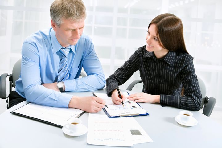 Business man and woman in a meeting