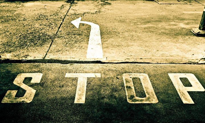 sepia of directional street sign